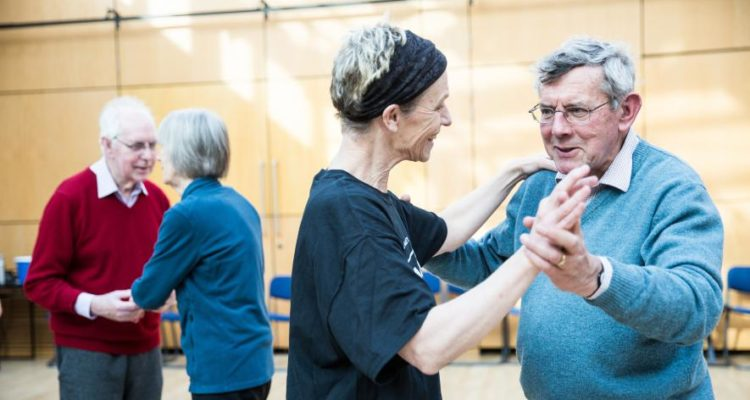 instructor dancing with participant
