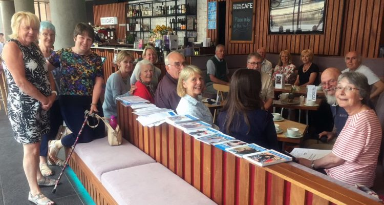 People sitting together at the drop-in cafe