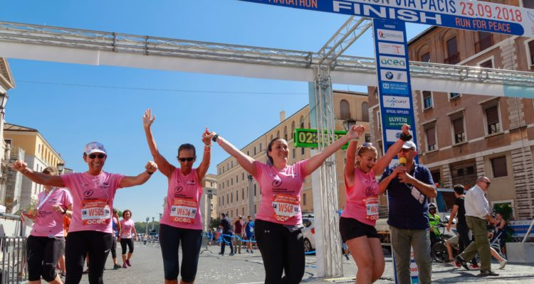 fundraisers running across a finish line