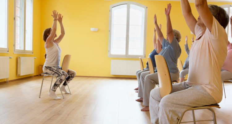 Group practising seated yoga