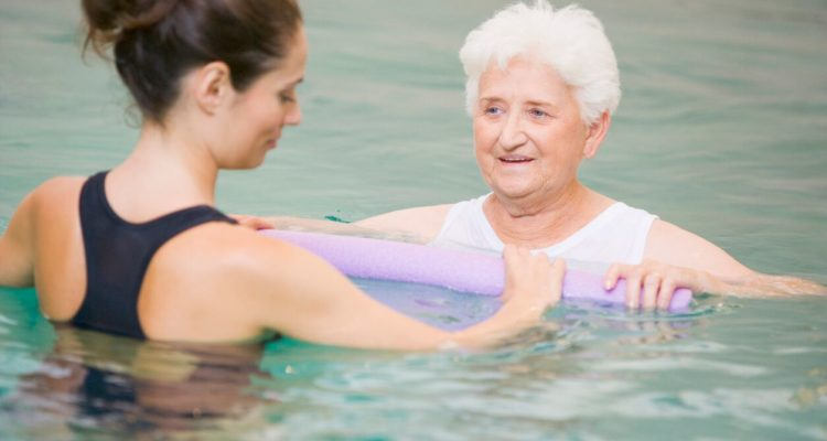 Woman in pool with instructor