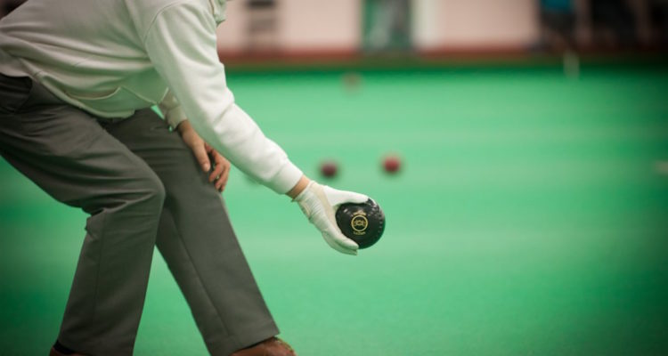 man playing indoor bowls