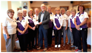 Weir Brown receiving cheque from Willowbrae Bowling Club Ladies Section, 2019